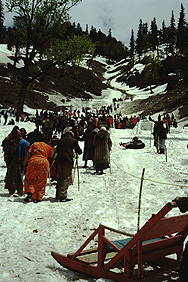 Indian tourists in the snow on the Rohtang pass north of Manali