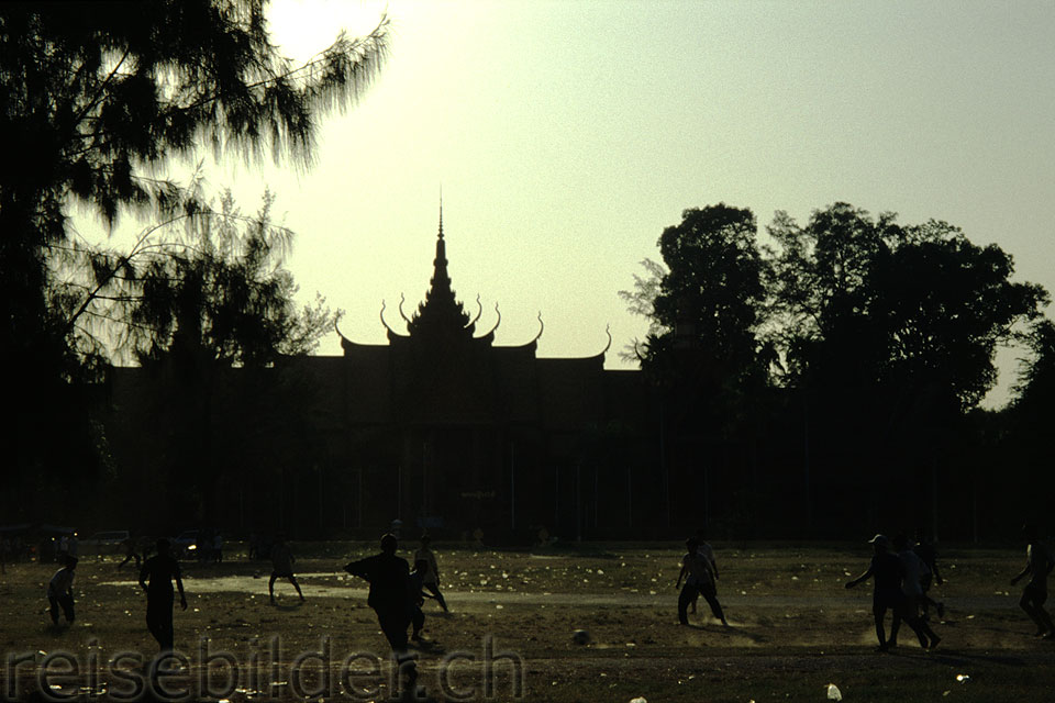 Children playing soccer in front of the National Museum in Phnom Penh