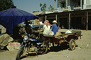 Main means of transport in Cambodia: motorcycles with trailers